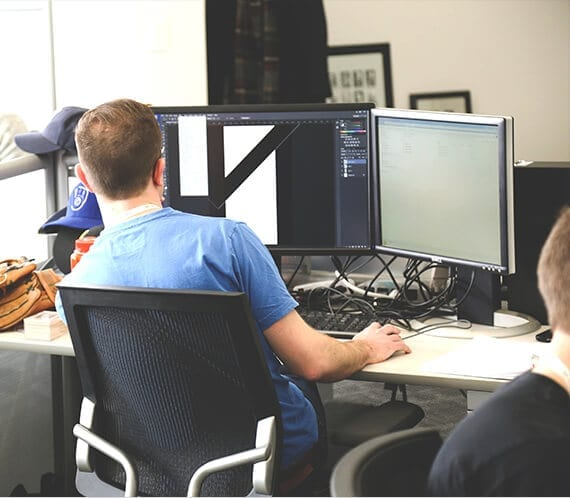 Man at work with two desktop computer screens